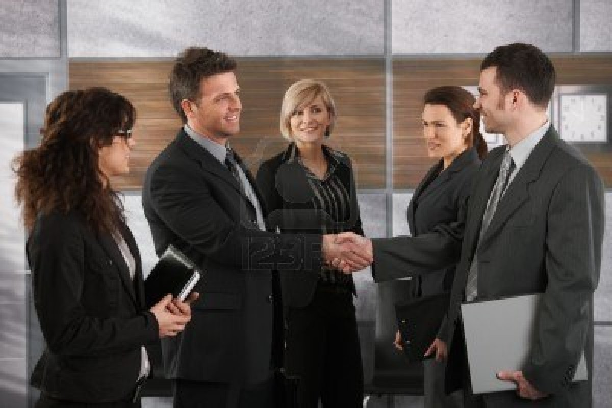 6711491 Happy Businesspeople Shaking Hands Greeting Each Other Before Business Meeting In Office